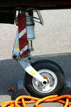 Nosewheel Hawk T mark 1, chocked and pinned, by Tony